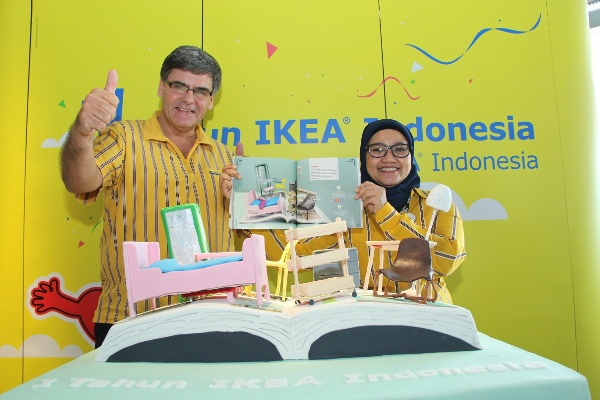 IKEA Anniversary Cake with Mark Magee and Eliza Fazia. (man)