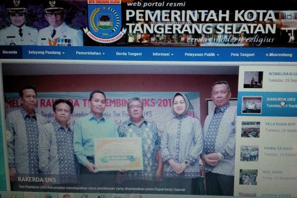 Penampakan website resmi Pemkot Tangsel sebelum adanya larangan Bawaslu. (ymw)