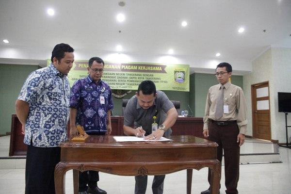 Penandatanganan nota Kerjasama Pemkot dan TP4D Kejari Tangerang. (ist)