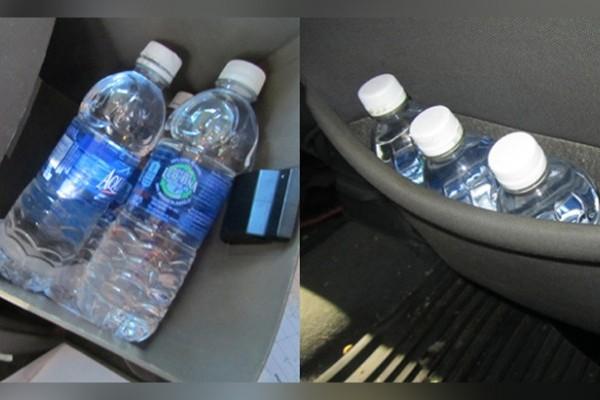 Air mineral disimpan di dalam mobil. (bbs)